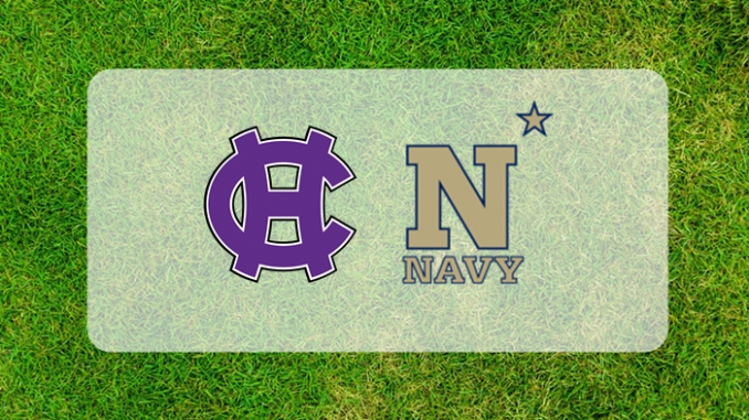 Navy-Holy Cross logos on grass