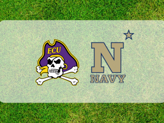 Navy and East Caroline logos on grass field