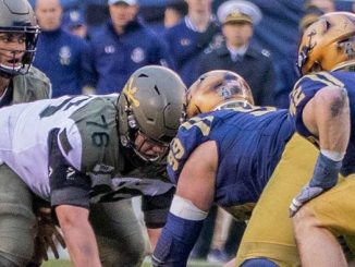 Army and Navy football players